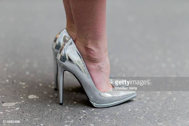 Fashion blogger Barbora Ondrackova wearing silver Asos heels on March 10 2016 in Berlin Germany