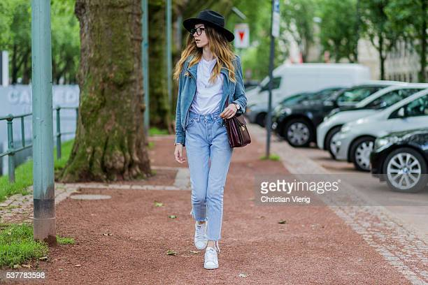 Fashion blogger Beatrice Gutu wearing a Set suede jacket a white Asos tshirt Levis denim jeans vintage bag glasses a black Brixton hat and white...