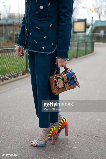 Fashion Blogger Benedetta Mariotti wears a Zara customized jacket Mauro Grifoni jeans Paula Cademartori shoes and bag on day 6 during Paris Fashion...
