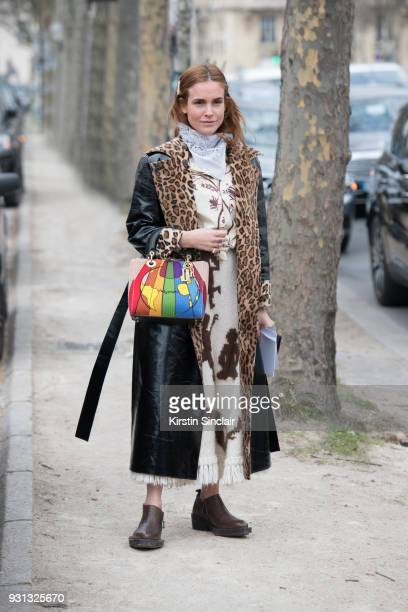 Fashion blogger Blanca Miro Scrimieri wears a Stand coat Eytys shoes Wald Berlin scarf and a Dior bag day 2 of Paris Womens Fashion Week...