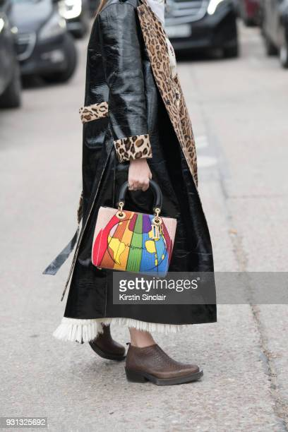 Fashion blogger Blanca Miro Scrimieri wears a Stand coat Eytys shoes and a Dior bag day 2 of Paris Womens Fashion Week Spring/Summer 2018 on February...