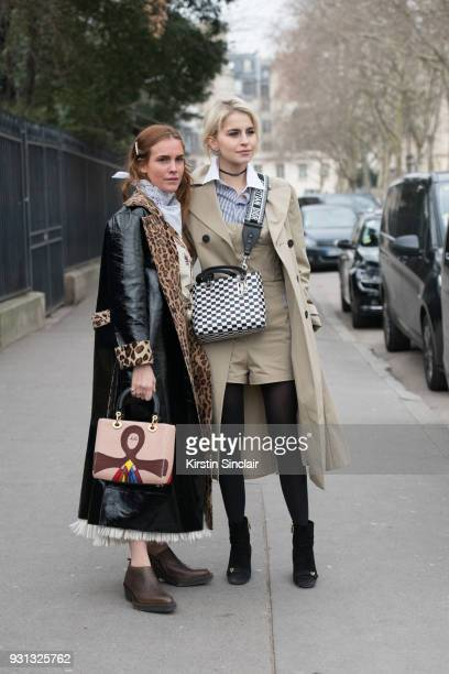 Fashion blogger Blanca Miro Scrimieri wears a Stand coat Eytys shoes Wald Berlin scarf and a Dior bag with Fashion blogger Caroline Daur wearing all...