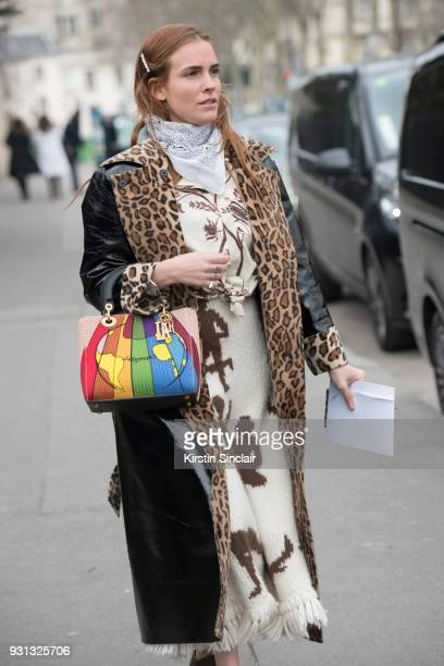 Fashion blogger Blanca Miro Scrimieri wears a Stand coat Wald Berlin scarf and a Dior bag day 2 of Paris Womens Fashion Week Spring/Summer 2018 on...