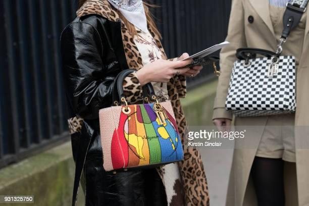 Fashion blogger Blanca Miro Scrimieri wears a Stand coat Wald Berlin scarf and a Dior bag with Fashion blogger Caroline Daur wearing all Dior day 2...