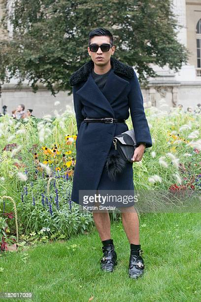 Fashion Blogger Bryan Boy wears Acne coat, Fendi bag, Christian Dior sunglasses and Balenciaga shoes on day 8 of Paris Fashion Week Spring/Summer...