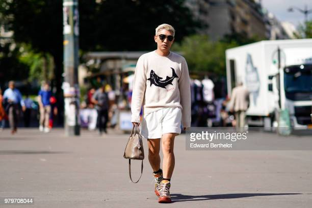 Fashion blogger Bryanboy wears sunglasses a beige pullover white shorts a bag outside OffWhite during Paris Fashion Week Menswear SpringSummer 2019...