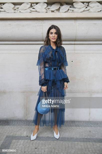 Fashion blogger Camila Coelho attends the Elie Saab show as part of the Paris Fashion Week Womenswear Spring/Summer 2018 on September 30 2017 in...