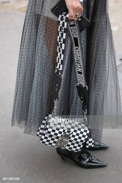 Fashion blogger Camila Coelho wears all Dior day 2 of Paris Womens Fashion Week Spring/Summer 2018 on February 27 2018 in London England