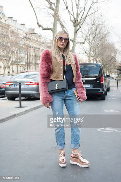 Fashion Blogger Camilla Carril wears a Georgine jacket and top Stella McCartney shoes Levis jeans YSL bag and Gucci sunglasses on day 8 during Paris...