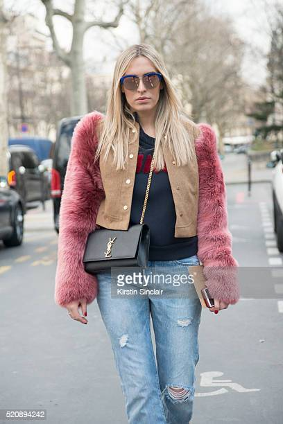 Fashion Blogger Camilla Carril wears a Georgine jacket and top YSL bag Levis jeans and Gucci sunglasses on day 8 during Paris Fashion Week...