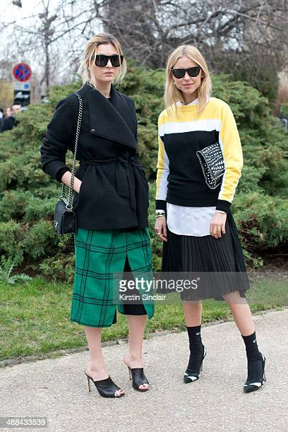 Fashion blogger Camille Charriere wears a Filippa K jacket Chanel bag Tibi Culottes Gianvito Rossi shoes And Other stories sunglasses with Fashion...