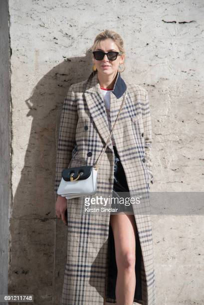 Fashion blogger Camille Charriere wears a Mango coat JW Anderson bag Céline sunglasses on day 3 during Paris Fashion Week Autumn/Winter 2017/18 on...