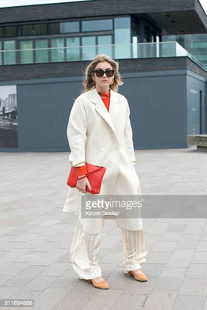 Fashion blogger Camille Charriere wears a Paul Smith coat Joseph trousers Rag and Bone top Claritone bag and Celine sunglasses on day 3 during London...