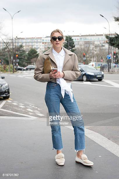Fashion Blogger Camille Charriere wears Tome NYC jacket Vetements jeans Loewe bag and Gucci shoes on day 6 during Paris Fashion Week Autumn/Winter...