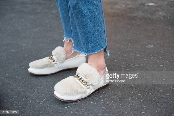 Fashion Blogger Camille Charriere wears Vetements jeans and Gucci shoes on day 6 during Paris Fashion Week Autumn/Winter 2016/17 on March 6 2016 in...