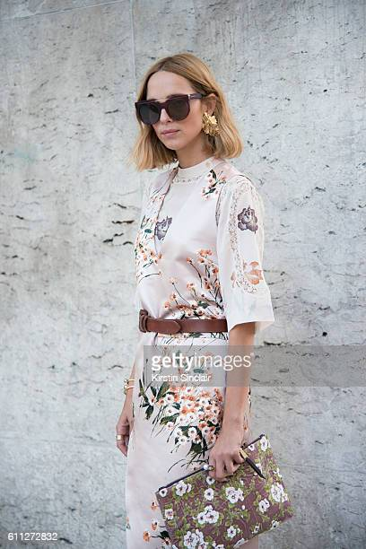 Fashion blogger Candela November wears a Rochas dress Alexander McQueen sunglasses Annelise Michelson earrings and bag and Vionnet jewellery on day 2...