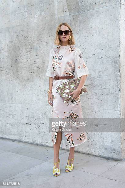 Fashion blogger Candela November wears a Rochas dress and shoes Alexander McQueen sunglasses Annelise Michelson earrings and bag and Vionnet...