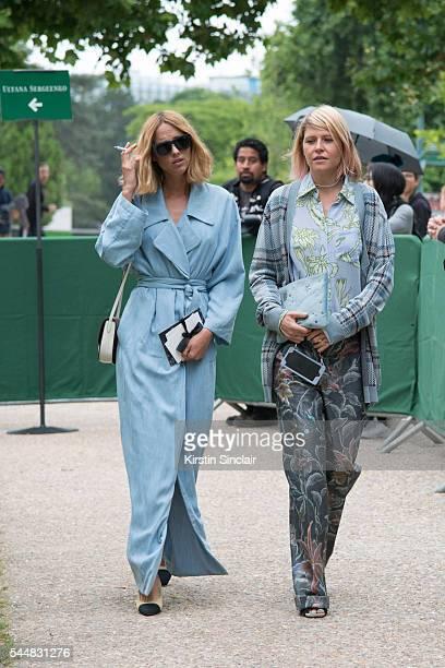 Fashion blogger Candela Novembre and Fashion Stylist Elisa Nalin who wears a Blumarine dress Chanel shoes and Celine bag on day 1 of Paris Haute...