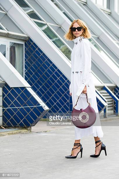 Fashion blogger Candela Novembre poses after the Issey Miyake show on day 4 of Paris Womens Fashion Week Spring/Summer 2017Êon September 30 2016 in...