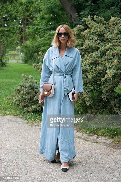 Fashion Blogger Candela Novembre wears a Blumarine dress Chanel shoes Celine bag and Retro superfuture sunglasses on day 1 of Paris Haute Couture...