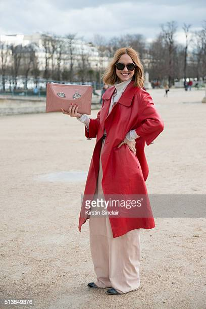 Fashion blogger Candela Novembre wears a Marni jacket Trussardi trousers and shirt Rochas bag Kyme sunglasses and Marni shoes on day 4 during Paris...