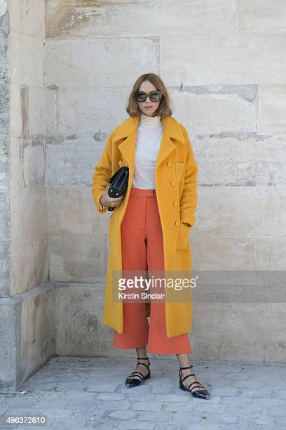 Fashion Blogger Candela Novembre wears a Rochas coat MSGM trousers Zara shoes and top and Jimmy Choo bag on day 5 during Paris Fashion Week...