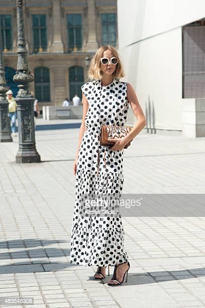 Fashion Blogger Candela Novembre wears an Antonio Marras dress Sergio Rossi shoes MSGM bag and Spektre sunglasses on day 2 of Paris Fashion Week...