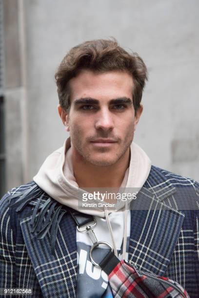Fashion blogger Carlo Sestini wears a Prada coat Blood Brothers hooded top and bag day 3 of London Mens Fashion Week Autumn/Winter 2018 on January 08...