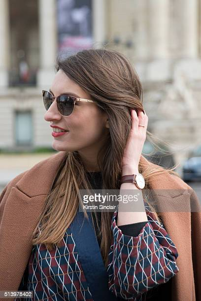 Fashion Blogger Carlotta Rubaltelli wears an H and M coat Alyzi suit and Leisure Society sunglasses on day 5 during Paris Fashion Week Autumn/Winter...