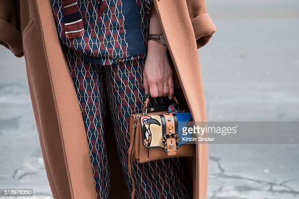 Fashion Blogger Carlotta Rubaltelli wears an H and M coat Paula Cademartori bag and an Alyzi suit on day 5 during Paris Fashion Week Autumn/Winter...