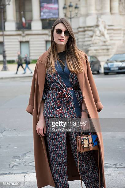 Fashion Blogger Carlotta Rubaltelli wears an H and M coat Paula Cademartori bag Alyzi suit and Leisure Society sunglasses on day 5 during Paris...