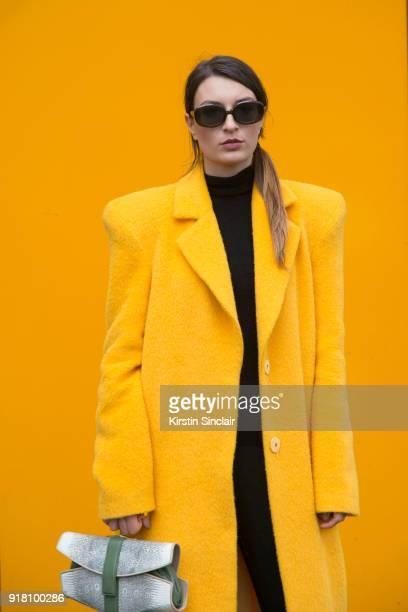 Fashion blogger Carlotta Rubatelli of Style And Trouble wears an Annakiki coat Francesca Castagnacci bag day 6 of Paris Womens Fashion Week...