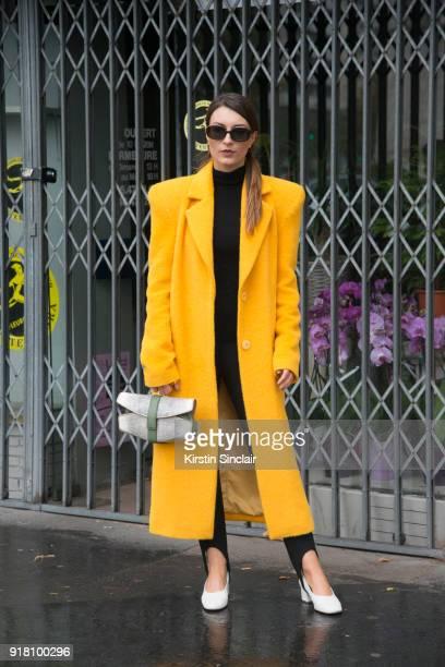 Fashion blogger Carlotta Rubatelli of Style And Trouble wears an Annakiki coat Francesca Castagnacci bag and Zara shoes day 6 of Paris Womens Fashion...
