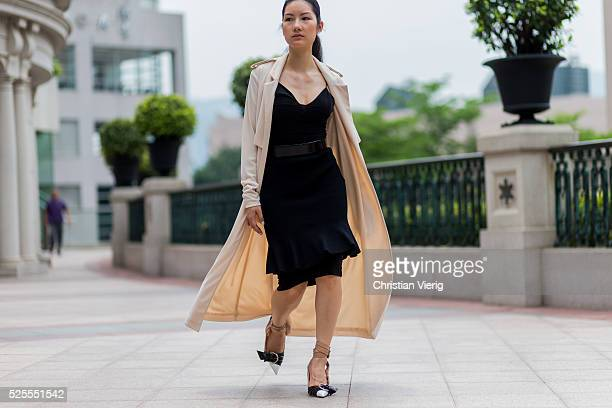 Fashion Blogger Carol CharlotteBlair wearing a beige ST Studio trench coat and black dress Dior heel shoes on April 28 2016 in Hong Kong Hong Kong