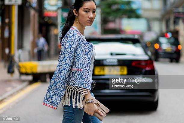 Fashion Blogger Carol CharlotteBlair wearing a blue white Tularosa Santa Fe Fringe Jacket from REVOLVE a nude Hermes wallet blue Acne denim jeans a...