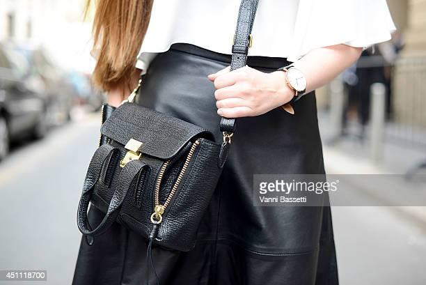 Fashion blogger Carola de Armas is seen wearing Zara top HM skirt Daniel Wellington watch and Phillip Lim bag after Gucci show on June 23 2014 in...