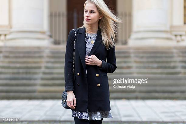 Fashion Blogger Caroline Daur is wearing a Zara dress Chanel bag and a Edited blazer on November 23 2015 in Berlin Germany