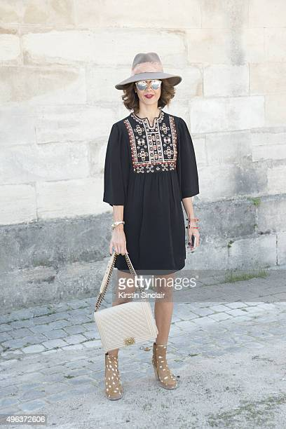Fashion Blogger Carrie Colbert wears an Isabel Marant dress Laurence Dacade boots Eugenia Kim hat Dior sunglasses and a Chanel bag on day 5 during...