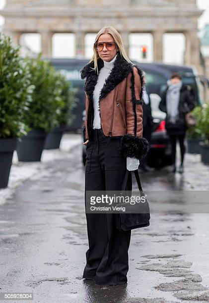 Fashion blogger Celine Aargaard wearing Gucci sunglasses jacket pants from Dorothee Schumacher turtleneck from elle ill outside Dorothee Schumacher...
