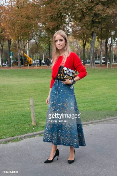Fashion blogger Charlotte Groeneveld of The Fashion Guitar wears a Marc Cain sweater Dior skirt bag and shoes day 2 of Paris Womens Fashion Week...