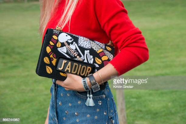 Fashion blogger Charlotte Groeneveld of The Fashion Guitar wears a Marc Cain sweater Dior skirt and bag day 2 of Paris Womens Fashion Week...