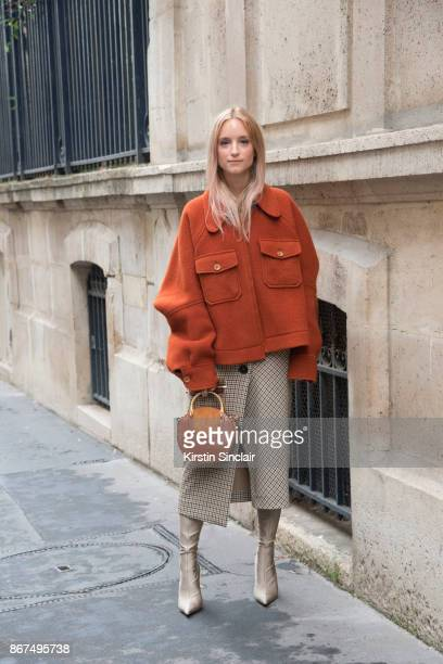 Fashion blogger Charlotte Groeneveld of The Fashion Guitar wears a Chloe coat and bag Zara skirt and Balenciaga boots day 3 of Paris Womens Fashion...