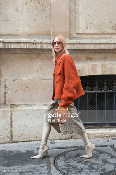 Fashion blogger Charlotte Groeneveld of The Fashion Guitar wears a Chloe coat sunglasses and bag Zara skirt and Balenciaga boots day 3 of Paris...