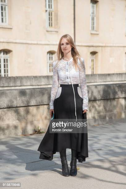 fashion blogger Charlotte Groeneveld of The Fashion Guitar wears a Nina Ricci top skirt and boots day 4 of Paris Womens Fashion Week Spring/Summer...
