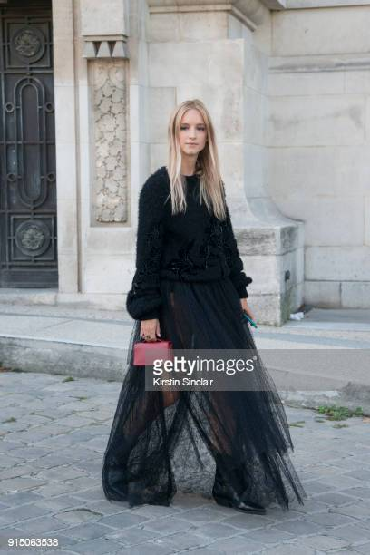 Fashion blogger Charlotte Groeneveld of The Fashion Guitar wears an Elie Saab sweater and skirt Dior bag and Sandro boots day 5 of Paris Womens...