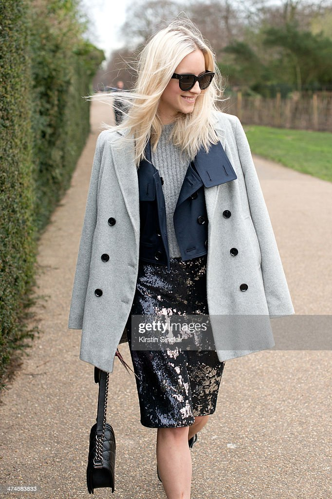 Fashion Blogger Charlotte Groeneveld wears a Chanel bag, Jaeger coat, Burberry jacket, Zara sweater and skirt and Celine sunglasses on day 4 of London Collections: Women on February 17, 2014 in London, England.