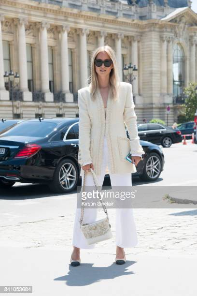 Fashion blogger Charlotte Groneveld wears Mih jeans Chanel Jacket bag and shoes and Celine sunglasses day 3 of Paris Haute Couture Fashion Week...