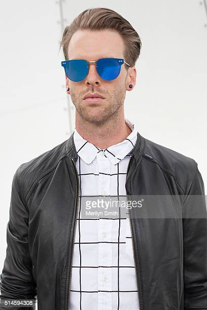 Fashion Blogger Chris BurtAllan wearing a Diesel jacket Factorie shirt and Spitfire sunglasses during the 2016 Melbourne Fashion Festival on March 9...