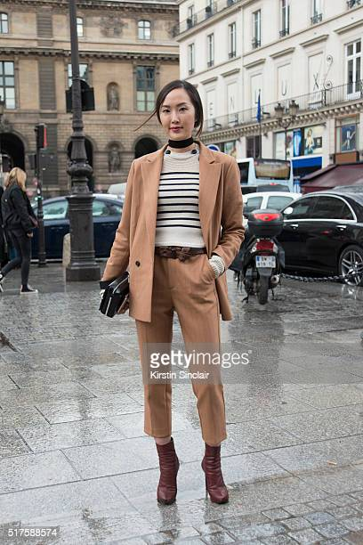 Fashion Blogger Chriselle Lim wears a Isabel Marant suit top and bag Lanvin shoes on day 4 during Paris Fashion Week Autumn/Winter 2016/17 on March 4...