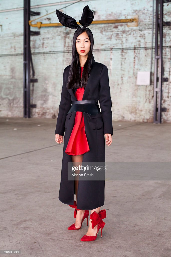 Fashion Blogger Cissy Zhang wears an Aminah Aedul Jillil shoes, Kate Spade dress and a Georgio Armani coat at Mercedes-Benz Fashion Week Australia 2015 at Carriageworks on April 14, 2015 in Sydney, Australia.